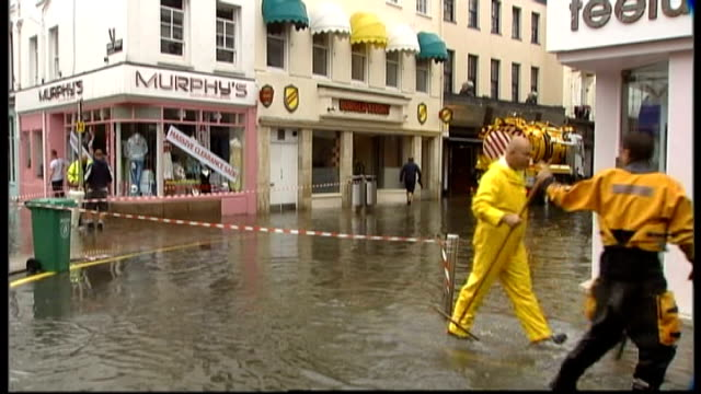 jersey flooded shopping streets people paddling in street - august stock videos & royalty-free footage
