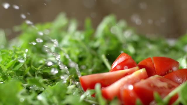 SLO MO Wet Chopped Tomato Falls On Arugula