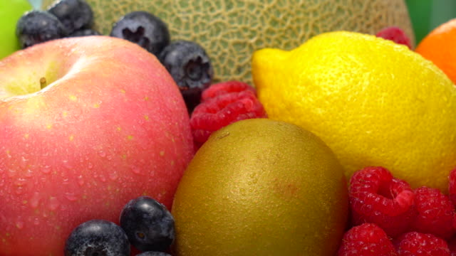 wet mix fruit rotating with macro shot - fruit bowl stock videos & royalty-free footage