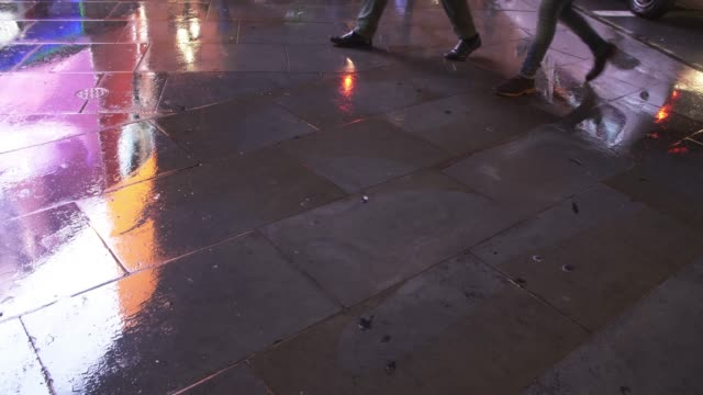 wet pavement reflecting city light - puddle stock videos & royalty-free footage