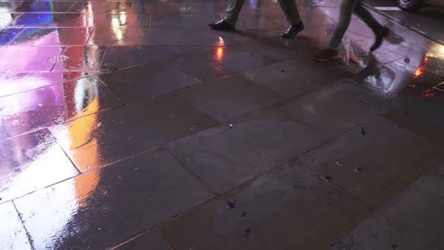 wet pavement reflecting city light - pavement stock videos & royalty-free footage