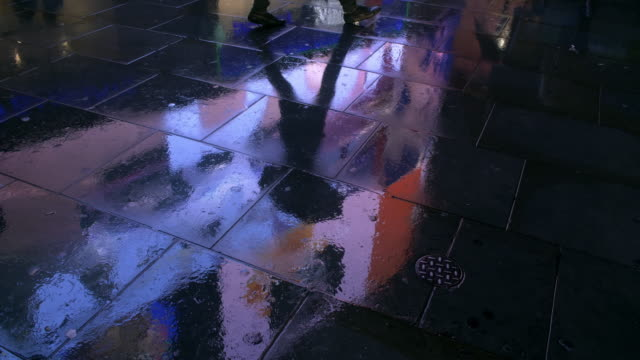 wet pavement reflecting city lights - neon stock videos & royalty-free footage