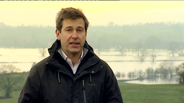wet weather may affect food prices upton upon severn reporter to camera float marker on flooded river setup and interview with owen paterson mp sot... - owen paterson stock videos and b-roll footage
