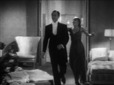 B/W 1936 wet woman hugging butler / feature