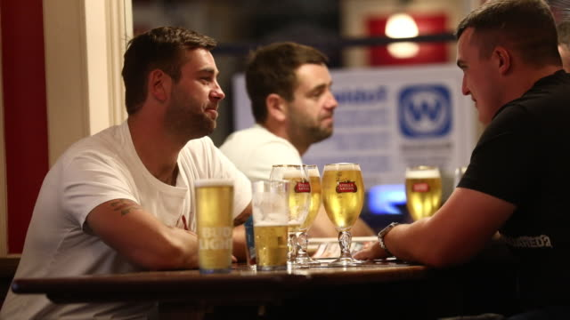 vídeos de stock, filmes e b-roll de wetherspoon pub in leicester square is reopened after government ease lockdown rules, in london, on saturday, july 4, 2020. - pub