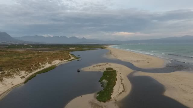 wetland flowing into the ocean - lagoon stock videos & royalty-free footage