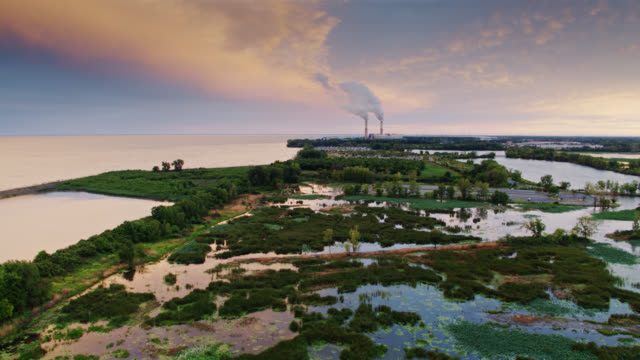 wetland on the shore of lake erie with coal fired power station - aerial - 発電所点の映像素材/bロール