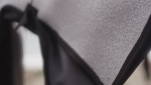 Wetsuit hung up to dry, close up