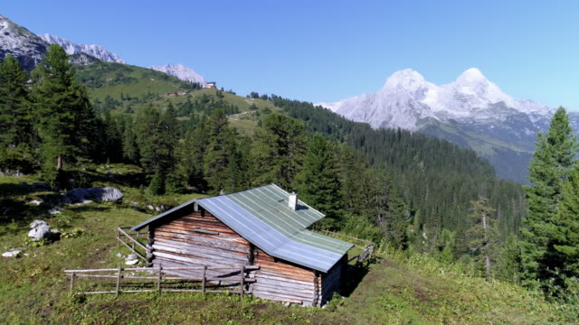 wetterstein mountains and king's house on schachen in bavaria - hut stock videos & royalty-free footage