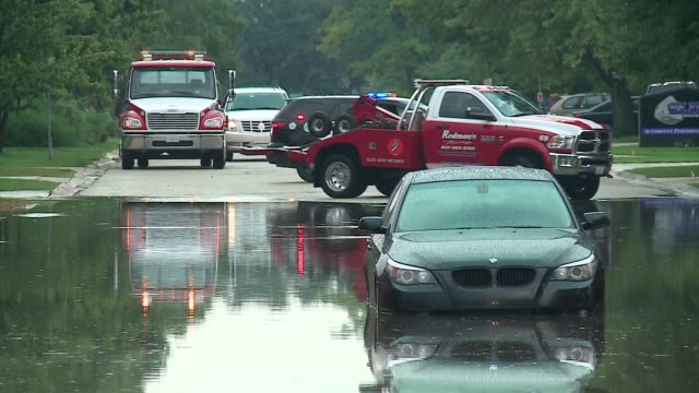 WGNTow Truck Pulls Out Car Stuck in Flood Water in Schaumburg Illinois on August 29 2016 Stormy weather moving across the Chicago area dumped heavy...