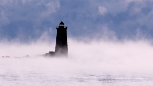 whaleback light in arctic sea smoke - maine stock videos & royalty-free footage