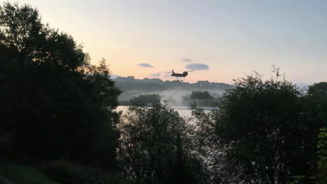 Thousands evacuated from town as dam at risk of bursting ENGLAND Derbyshire Whaley Bridge Helicopter carrying sandbags over Toddbrook Reservoir