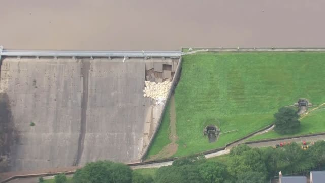 Thousands evacuated from town as dam at risk of bursting ENGLAND Derbyshire Whaley Bridge Dam with pile of sandbags on damaged area
