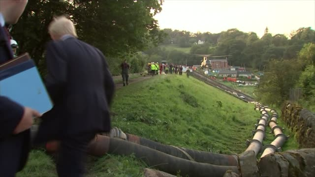 Thousands evacuated from town as dam at risk of bursting Whaley Bridge Derbyshire UK Boris Johnson MP overseeing work on dam talking to emergency...