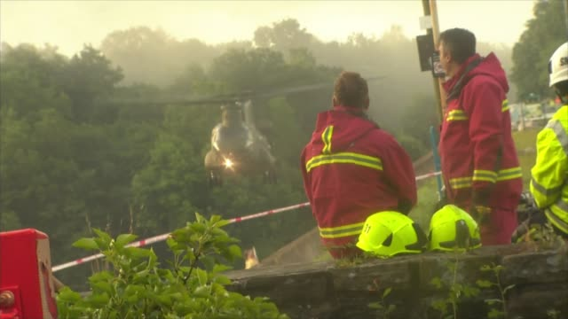 Thousands evacuated from town as dam at risk of bursting ENGLAND Derbyshire Whaley Bridge EXT Fire service watching RAF Chinook helicopter dropping...