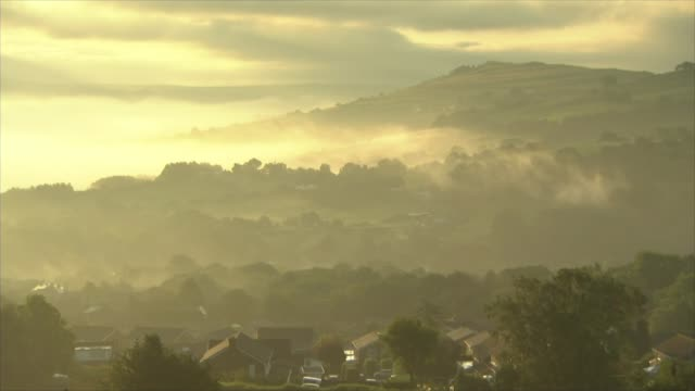 Thousands evacuated from town as dam at risk of bursting ENGLAND Derbyshire Whaley Bridge EXT Wide shots of landscape covered in mist RAF Chinook...