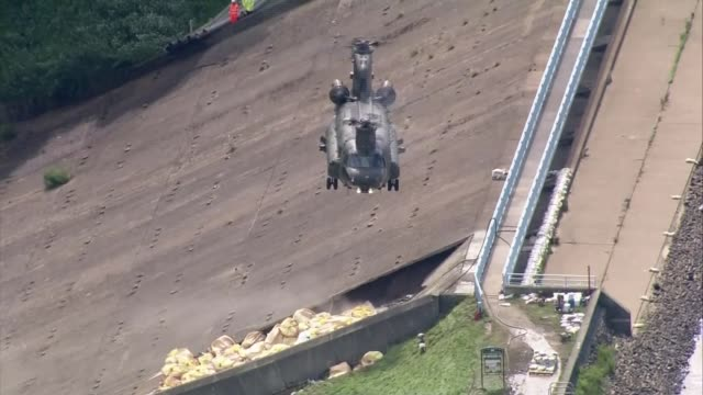 Whaley Bridge residents evacuate as new storms may cause dam to burst ENGLAND Derbyshire Whaley Bridge Toddbrook Reservoir EXT Helicopter hovering...