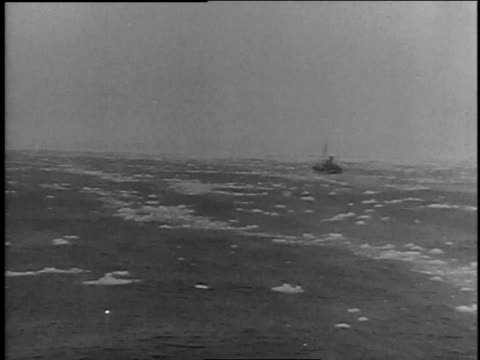whaling ship in rough seas / sailor manning harpoon gun on whaling vessel - anno 1947 video stock e b–roll