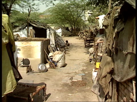 what are the issues facing the forthcoming earth summit in brazil cr 3017 gv shacks in shanty town zoom in to baby playing on ground - 掘建て小屋点の映像素材/bロール