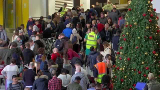 what dangers do drones pose, and how can they be countered?; england: west sussex: gatwick airport: int crowds of people stranded in terminal.... - gatwick airport stock videos & royalty-free footage