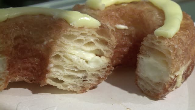 what do you get when you cross a buttery french croissant with a deep fried crispy us doughnut you get pastry chef dominique ansels cronut a creation... - french food stock videos & royalty-free footage