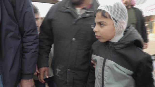 what happened to one syrian family in aftermath of airstrike; syria, northern syria; various shots of family members who survived air strike arriving... - holding stock videos & royalty-free footage