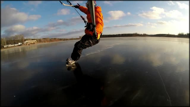 """""""what happens when you bring a kite to a frozen lake? kite skating! check out how cool and fun this looks!"""" - weitere themen stock-videos und b-roll-filmmaterial"""