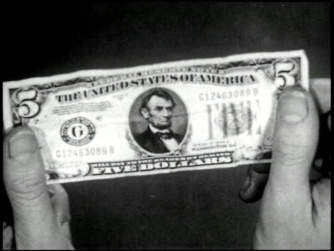vídeos de stock e filmes b-roll de what is money? - 4 of 10 - veja outros clipes desta filmagem 2517