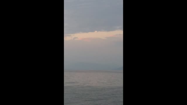 what looks like a pair of fireballs appear over lake ohrid in the republic of macedonia. what do you think it is? let us know! - fireball stock videos & royalty-free footage