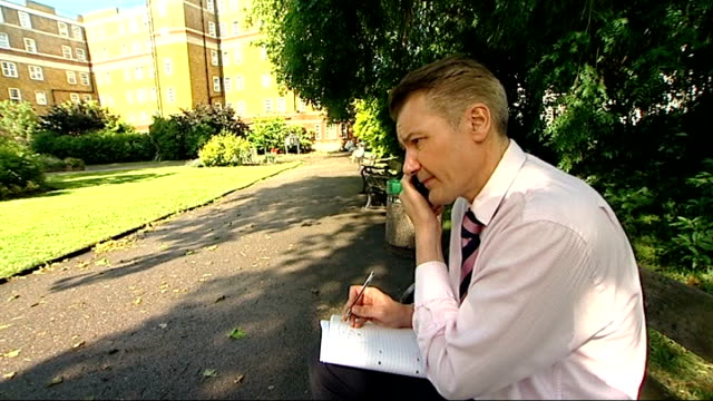 vídeos y material grabado en eventos de stock de what would you cut? / value added tax fraud; ext reporter telephoning tradesmen asking for cash in hand transaction - iva