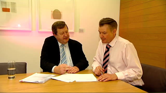 vídeos y material grabado en eventos de stock de what would you cut? / value added tax fraud; int stephen herring and reporter looking at documents on table stephen herring interview sot - iva