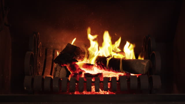 what's winter without a cozy fire to cuddle up to? - warming up stock videos & royalty-free footage