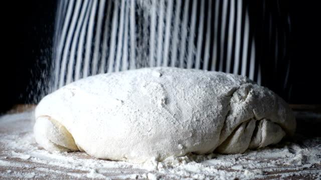 wheat flour falling dough - dough stock videos & royalty-free footage
