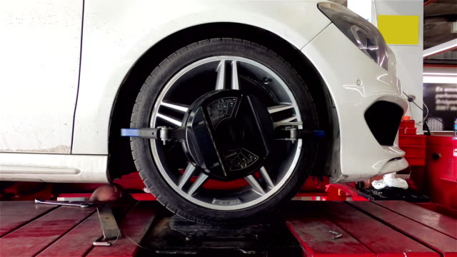 wheel alignment machine clamp - 4k resolution - clamp stock videos & royalty-free footage