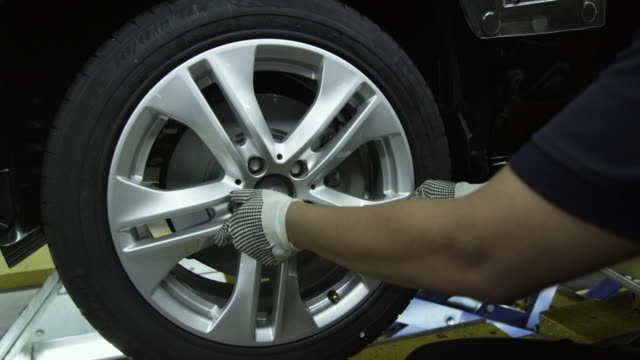 cu wheel being assembled on car on production line / samut prakan, bang muang mai, thailand - car plant stock videos & royalty-free footage