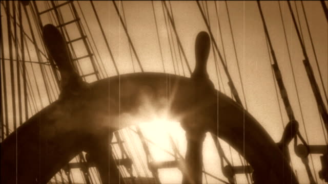 wheel of an old sailing ship - stylized old movie - helm stock videos & royalty-free footage