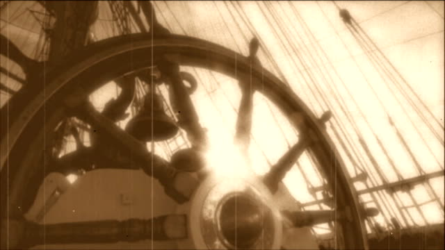 wheel of an old sailing ship - stylized old movie - mast sailing stock videos & royalty-free footage