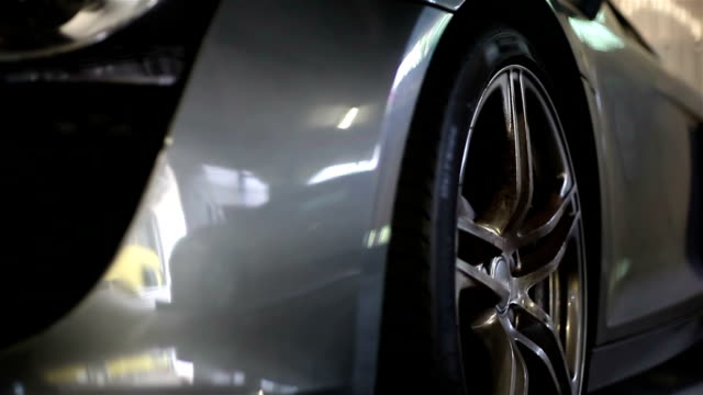 stockvideo's en b-roll-footage met wheel of sport car - overvloed