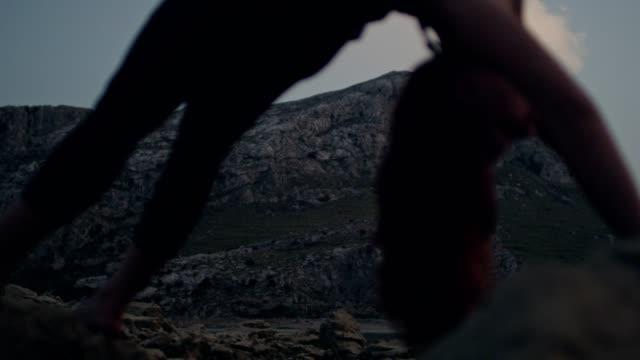 wheel pose near mountain lake - mountain pose stock videos & royalty-free footage
