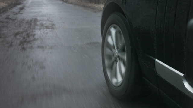 a wheel spins as a car traveling - ridge stock videos & royalty-free footage
