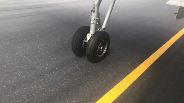 wheel touching the runway from the plane - wheel stock videos & royalty-free footage