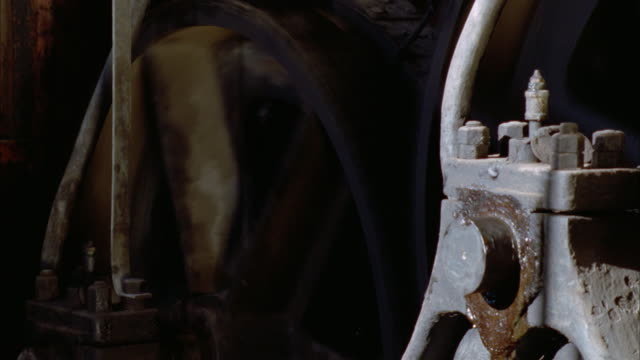 a wheel turns on an antique machine. available in hd. - antique stock videos & royalty-free footage