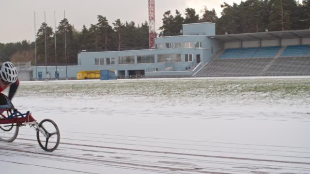 wheelchair athlete racing in winter - sports training点の映像素材/bロール