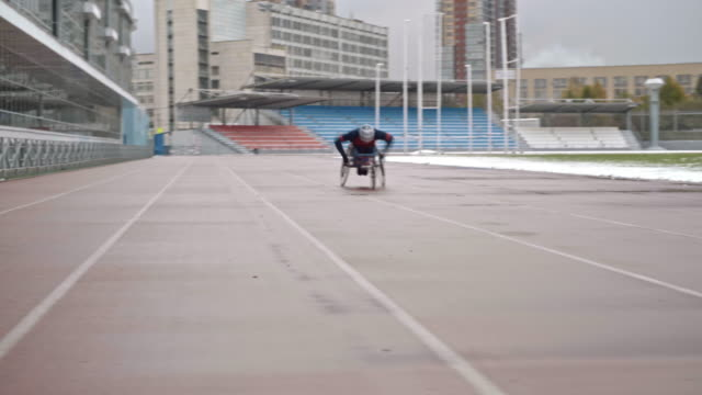 wheelchair athlete training on stadium - track and field event stock videos & royalty-free footage