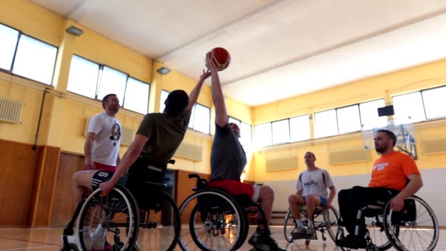 wheelchair athletes starting a game of basketball - basketball sport stock videos & royalty-free footage
