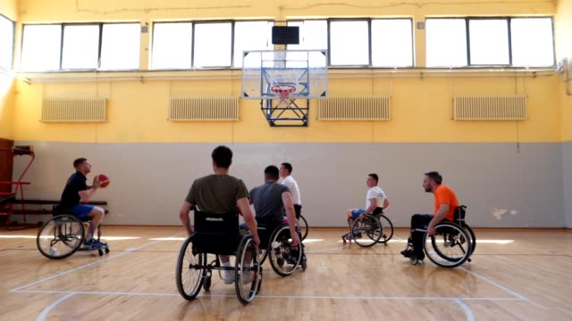 wheelchair basketball player shooting while playing a match - wheelchair basketball stock videos & royalty-free footage