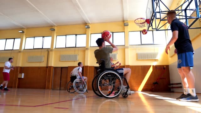 wheelchair basketball players training taking a shot indoors - wheelchair basketball stock videos & royalty-free footage