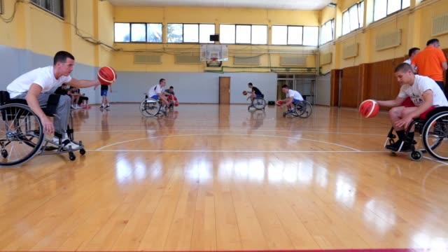 wheelchair basketball team training dribbling - wheelchair basketball stock videos & royalty-free footage