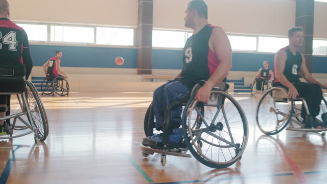 wheelchair basketball team warming up before competition - amputee stock videos & royalty-free footage
