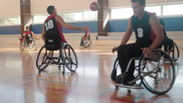 wheelchair basketball team warming up before competition - team sport stock videos & royalty-free footage